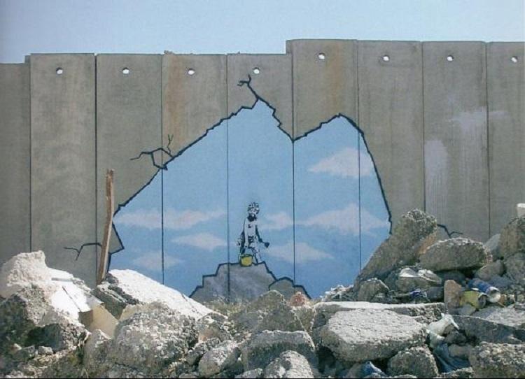 Street Art sul muro tra Cisgiordania e Israele