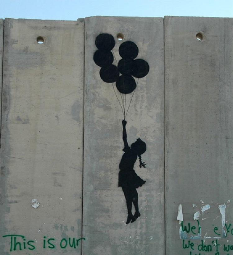 Il muro di Bansky tra Cisgiordania e Israele